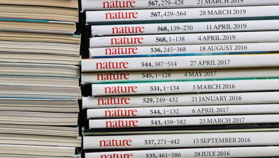 stack of nature journal issues