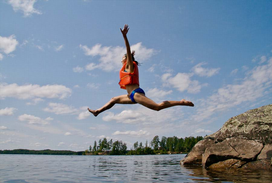 Person jumps with life jacket into the sea