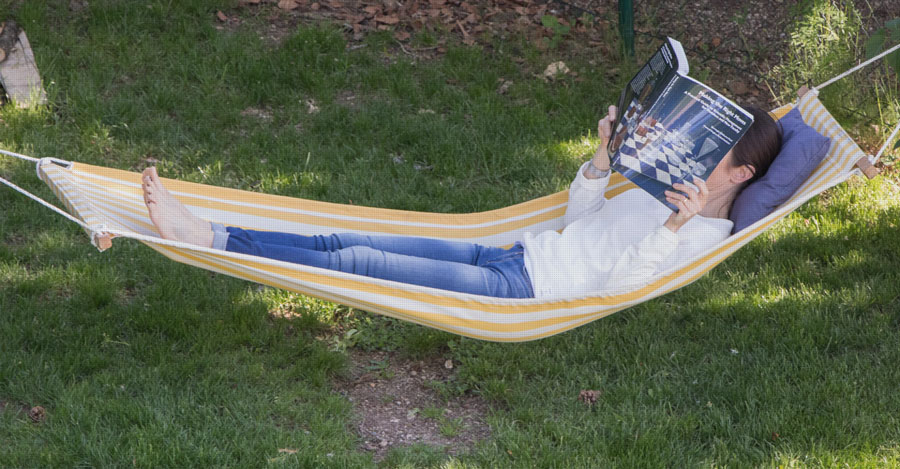 person working in hammock