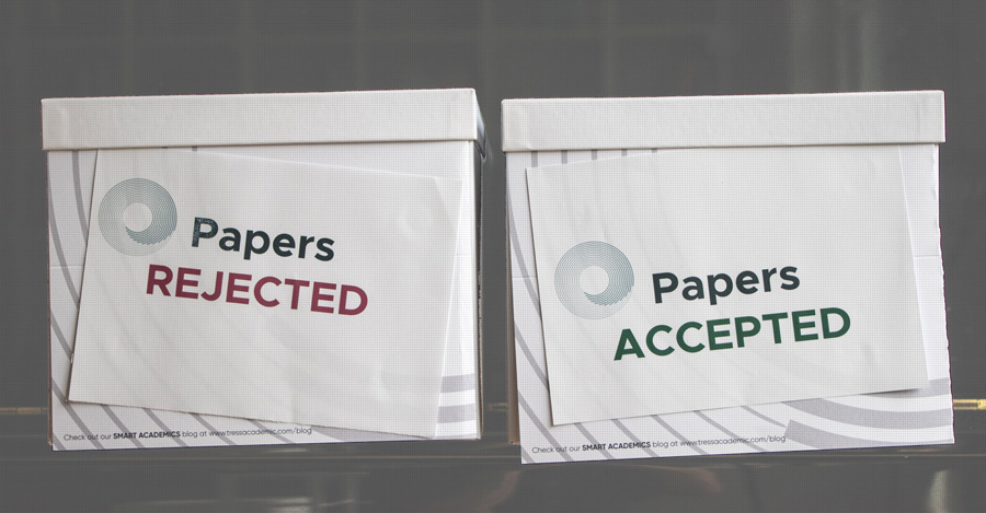Two boxes with rejected and acceopted papers
