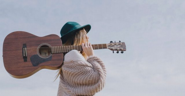 Woman with guitar enjoying her life!
