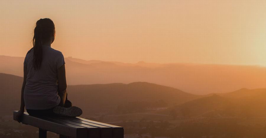 woman watching sunrise