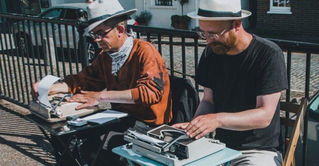 men reviewing paper